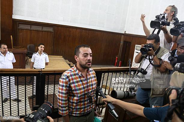 AlJazeera journalist Baher Mahmoud one of the three reporters sentenced to three year in jail by Egyptian court speaks to the media after a court...