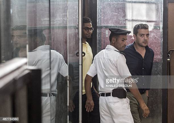 AlJazeera journalist Egyptian Baher Mohamed attends his trial at the Torah prison in Cairo on August 2 2015 An Egyptian court postponed for a second...