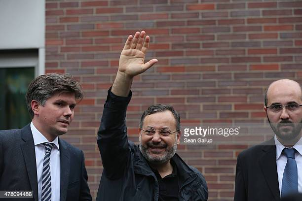 AlJazeera reporter Ahmed Mansour standing among lawyers waves to jubilant supporters moments after walking out a free man from the JVA Moabit prison...