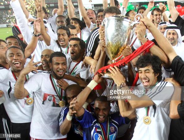 AlJazira players celebrate after they won the football final of the United Arab Emirates President's Cup at the Zayed Sports City in Abu Dhabi on...