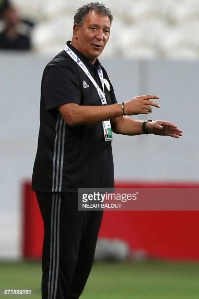 AlJazira's Dutch coach Henk ten Cate instructs his players during their AFC Champions League group B football match between Qatar's Lekhwiya and...