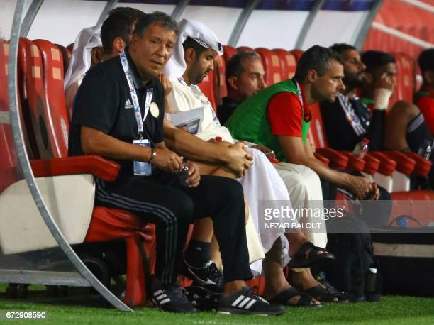 AlJazira's Dutch coach Henk ten Cate looks on during their AFC Champions League group B football match between Qatar's Lekhwiya and UAE's AlJazira on...