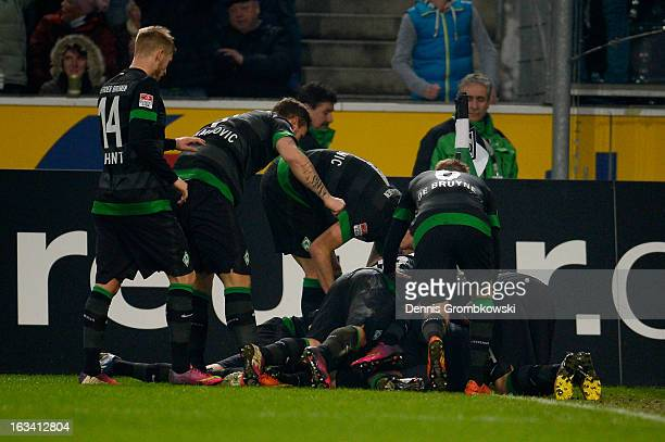 Alkesandar Ignjovski of Bremen celebrates with teammates after scoring a goal during the Bundesliga match between VfL Borussia Moenchengladbach and...