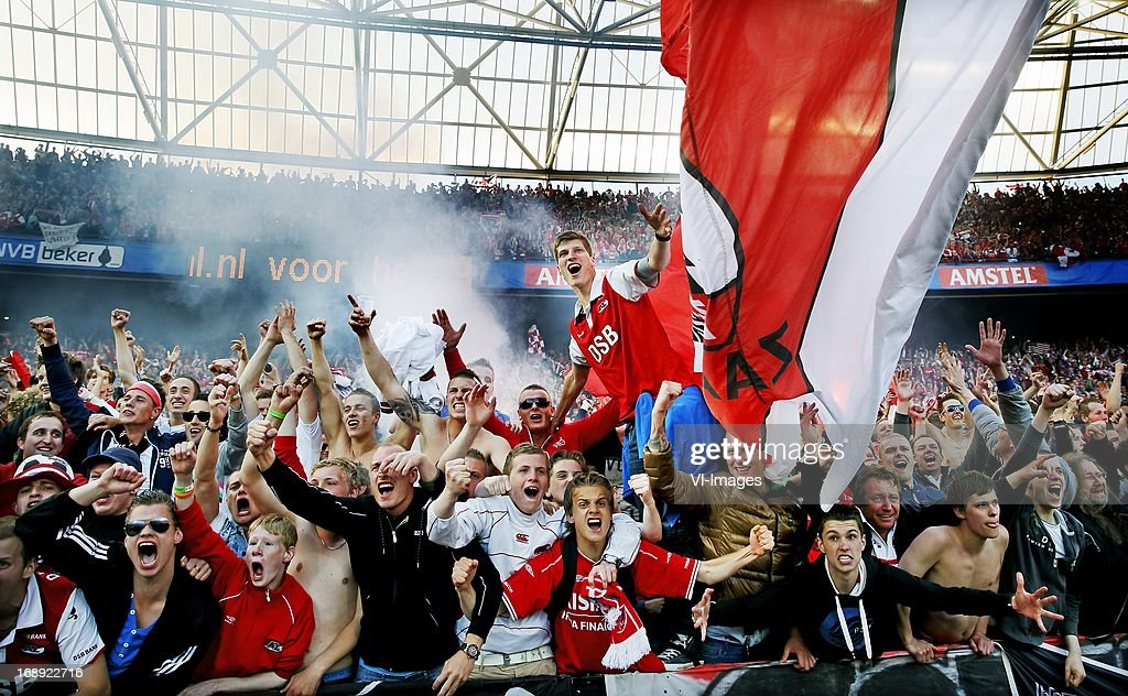 AZ Alkmaar fans celebrate during the Dutch Cup final match between AZ Alkmaar and PSV Eindhoven on May 9, 2013 at the Kuip stadium in Rotterdam, The Netherlands.