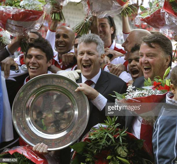 AZ Alkmaar's coach Louis van Gaal and director Dirk Scheringa pose with the champion plate as they celebrate their title of Champions of the...