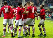 AZ Alkmaar's Dutch midfielder Dabney dos Santos celebrates with teammates after scoring a goal during the UEFA Europa League group L football match...