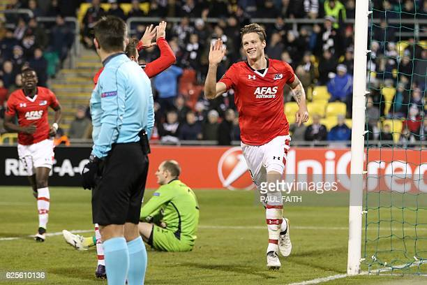 AZ Alkmaar's Dutch striker Wout Weghorst celebrates scoring the opening goal during the UEFA Europa League group D football match between Dundalk and...