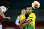 AZ Alkmaar's Etienne Reijnen vies with Anzhi Makhachkala's Gia Grigalava during UEFA Europa League round of 16 football match between FC Anzhi...