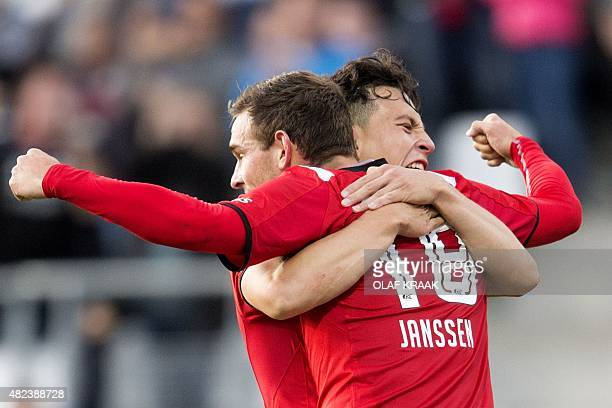 Alkmaar's forward Vincent Janssen celebrates with a temmate after AZ Alkmaar scored its second goal during the UEFA Europa League third qualifying...