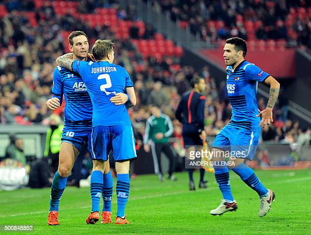 Alkmaar's forward Vincent Janssen is congratulated by hi teammate Swedish defender Mattias Johansson after scoring their team's second goal during...