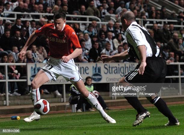 AZ Alkmaar's Julian Jenner and Newcastle United's Stephen Carr battle for the ball