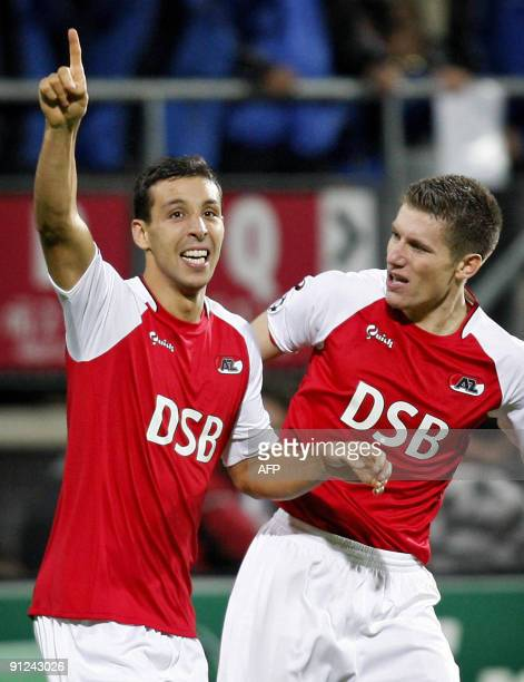 AZ alkmaar's Morcoccan forward Mounir El Hamdaoui celebrates with Belgian teammate Sebastien Pocognoli during their UEFA Champions League football...