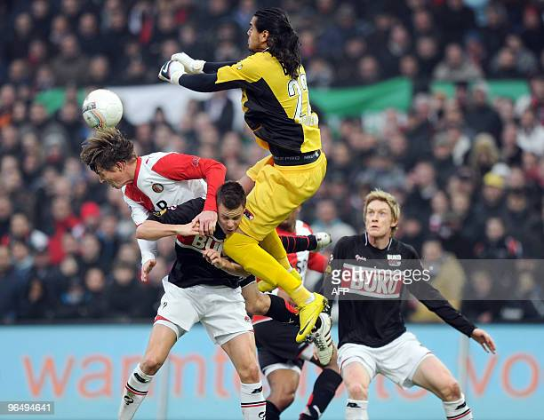 AZ Alkmaar's Niklas Moisander is stuck between Jon Dahl Tomasson of Feyenoord Rotterdam and AZ Alkmaar goalkeeper Sergio Romero during their Dutch...