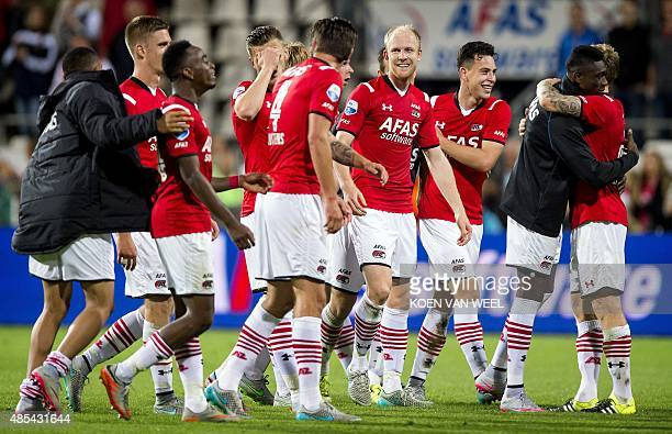 AZ Alkmaar's players cheer after winning the UEFA Europa League playoff football match between AZ Alkmaar and AFC Astra Giurgiu in Alkmaar on August...