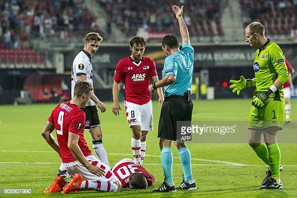 AZ Alkmaar's Stijn Wuytens lays injured on the ground during the UEFA Europa League Group D football match between Alkmaar and Dundalk on September...