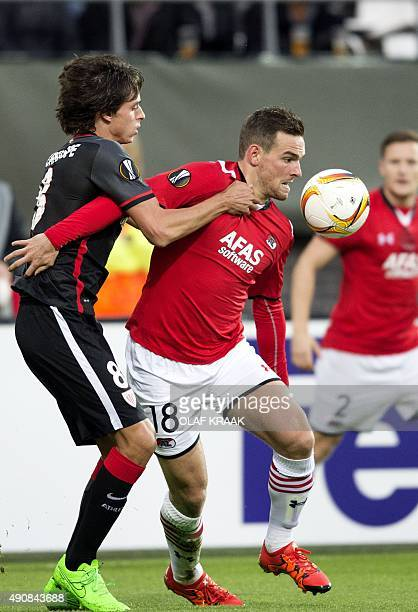 Alkmaar's Vincent Janssen vies with Bilbao's Carlos Gurpegi during the UEFA Europa League group L football match between AZ Alkmaar and Athletic...