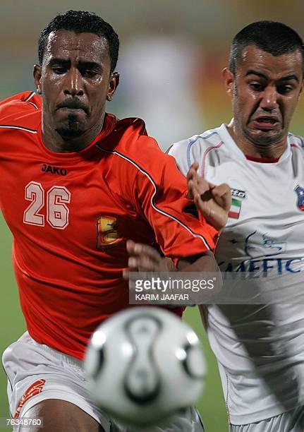 AlKuwait club player Yaqub alTaher vies with Dahi alNubi of Qatar's Umm Salal club during their football match for the Gulf Council Championship...