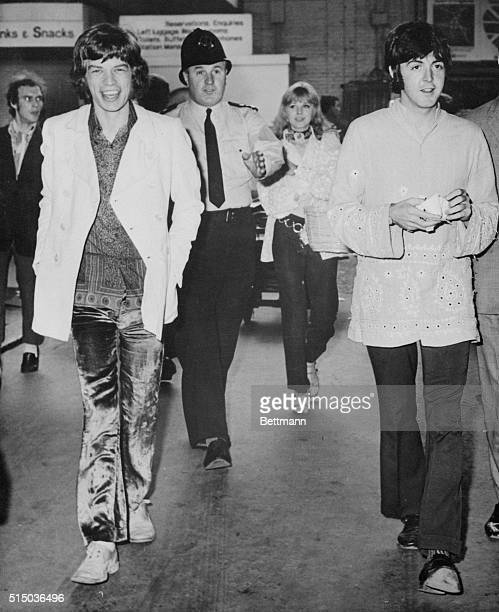 All aboard the 'love' trainBeatle Paul McCartney wearing an Indianstyle jacket and Mick Jagger of the Rolling Stones walk toward train en route to a...