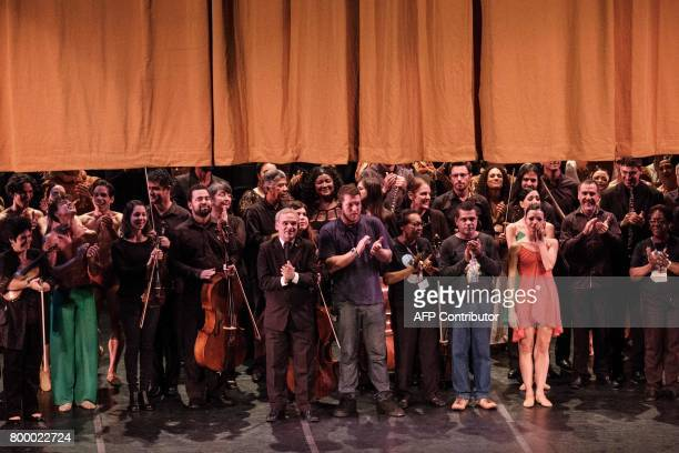 All artists and staff of the Rio de Janeiro's Theatro Municipal appear onstage after their performance of Carl Orff's 'Carmina Burana' at the Theatro...