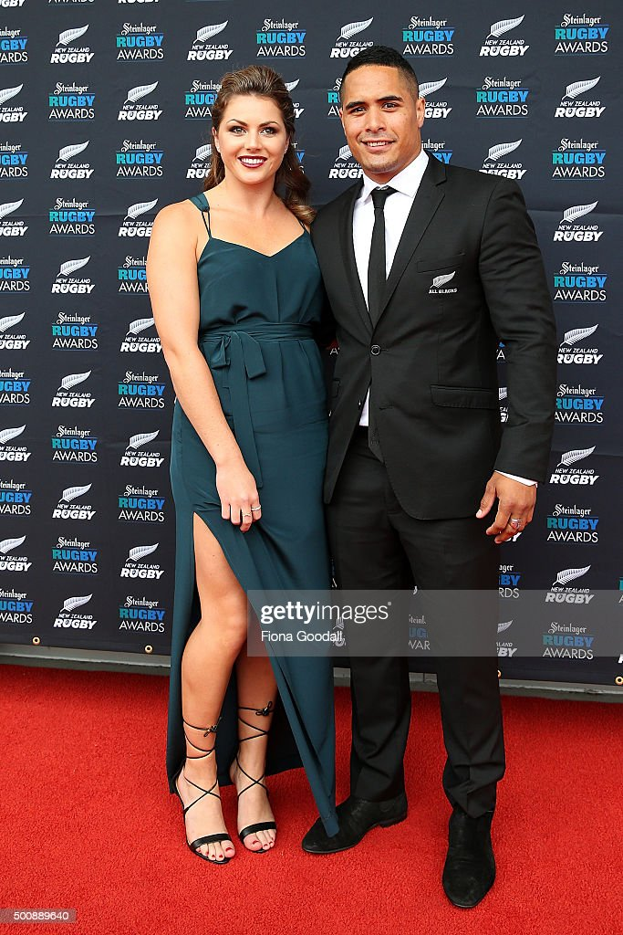 All Black Aaron Smith with partner Teagan Voykovich arrive at the 2015 Steinlager Rugby Awards on December 11 2015 in Auckland New Zealand
