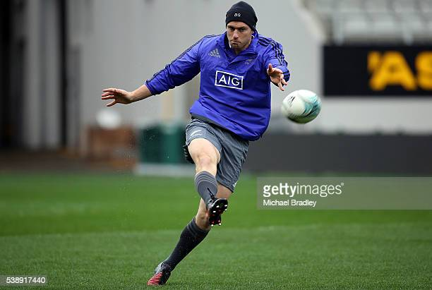 All Black Ben Smith kicks the ball during a New Zealand All Blacks training session at Eden Park on June 9 2016 in Auckland New Zealand