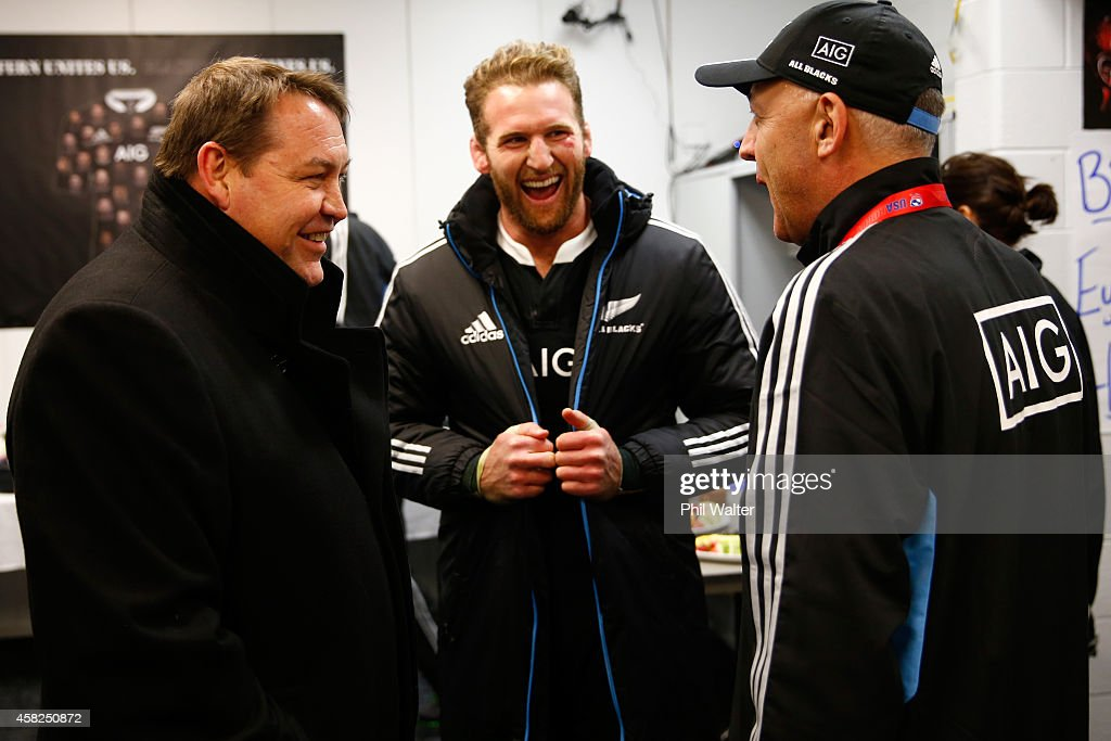 All Black captain Kieran Read (C) shares a laugh with coach Steve Hansen (L) and assistant manager Gilbert Enoka (R) in the dressing room following the International Test Match between the United States of America and the New Zealand All Blacks at Soldier Field on November 1, 2014 in Chicago, Illinois.