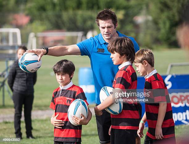 All Black captain New Zealand's Richie McCaw takes part in a practice with several children from different schools Chile in Santiago on December 04...
