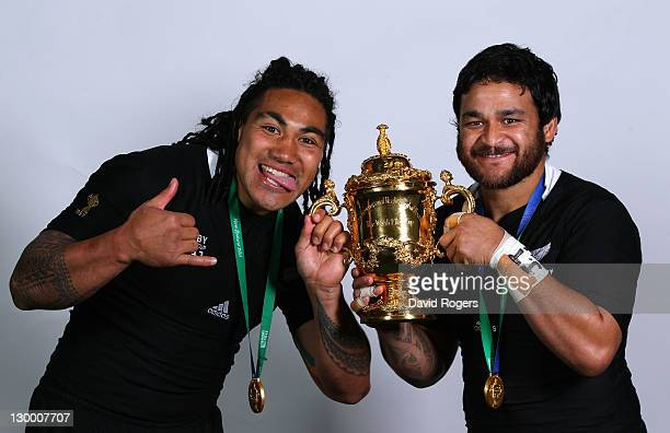 All Black centre Ma'a Nonu and scrumhalf Piri Weepu pose with the Webb Ellis Cup following their team's 87 victory during the 2011 IRB Rugby World...