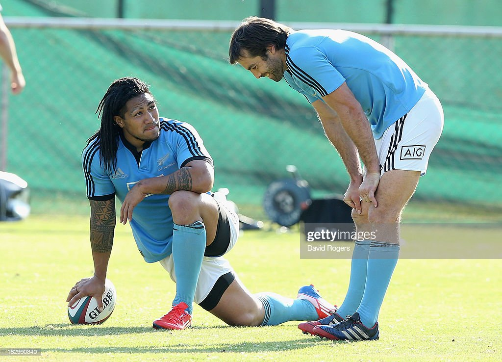 All Black centres Ma'a Nonu (L) and Conrad Smith, who will play their world record 51st Test together in the match against South Africa look on during the New Zealand All Blacks training session held at Wits University on October 3, 2013 in Johannesburg, South Africa.