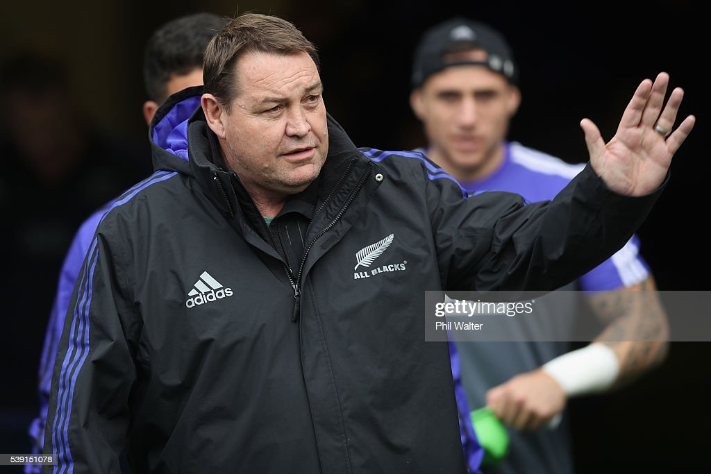All Black coach Steve Hansen of the All Blacks greets fans as he walks onto the field for the New Zealand All Blacks Captain's Run at Eden Park on...
