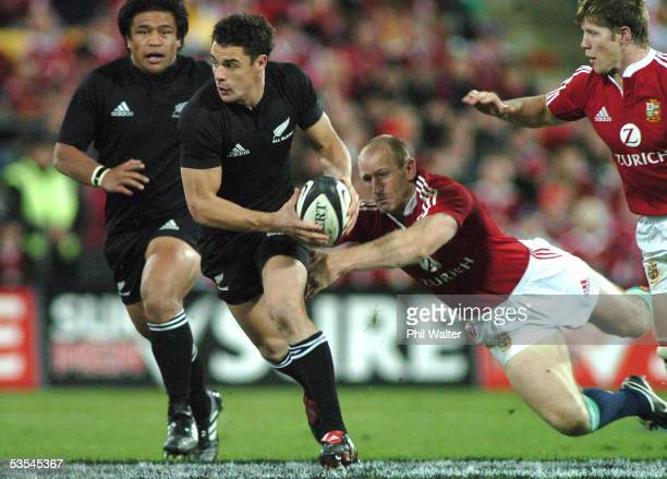 All Black Dan Carter leaves British and Irish Lions Gareth Thomas and Josh Lewsey behind in the 2nd rugby union match played at the Westpac Stadium...