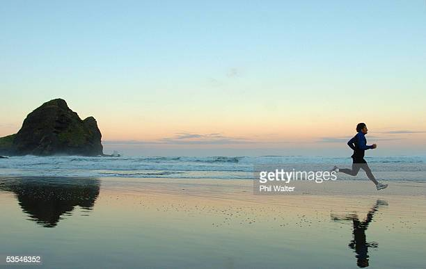 All Black Doug Howlett photographed running along Piha Beach at sunrise in Auckland New Zealand March 16th 2004 FOTOPRESS/Phil Walter