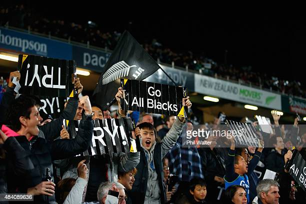 All Black fans celebrate a try during The Rugby Championship Bledisloe Cup match between the New Zealand All Blacks and the Australian Wallabies at...
