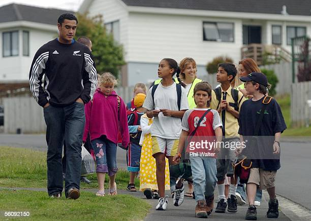 All Black Jerome Kaino walks with students from Target Road Primary School in a morning walking bus to school in Auckland New Zealand Tuesday...