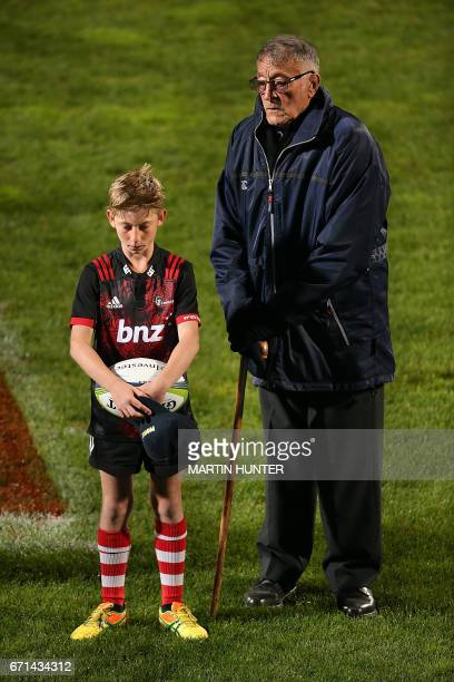 All Black rugby legend Tiny Hill and a ball boy take part in the ANZAC ceremony before the Super Rugby match between New Zealand's Canterbury...