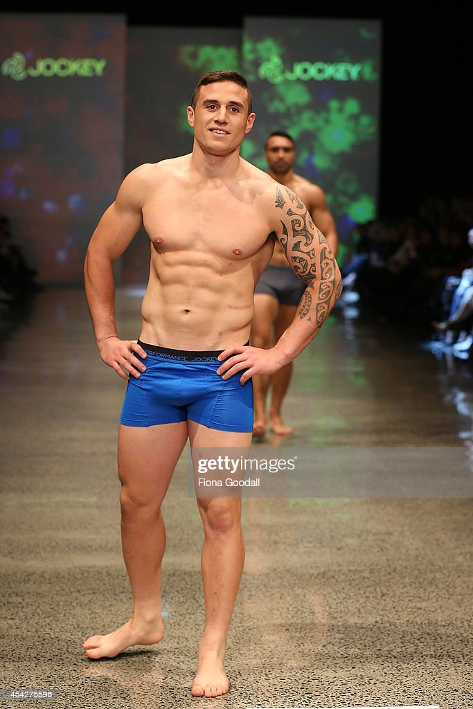 All Black rugby player TJ Perenara showcases designs by Jockey in the Resene Designer Selection Show by Woman's Day at New Zealand Fashion Week 2014...