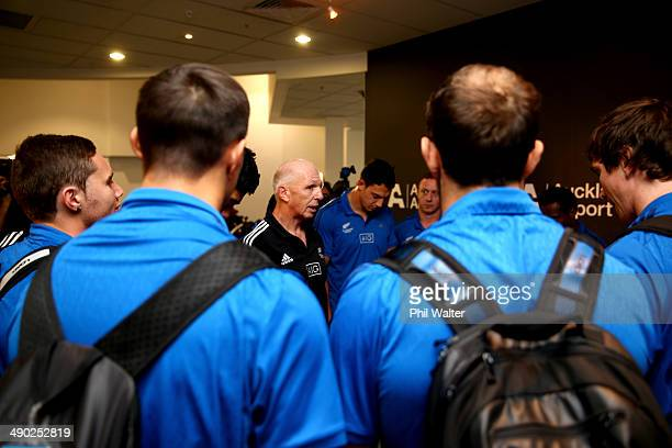 All Black Sevens coach Gordon Tietjens speaks to the team after arriving back at the Auckland International Airport on May 14 2014 in Auckland New...