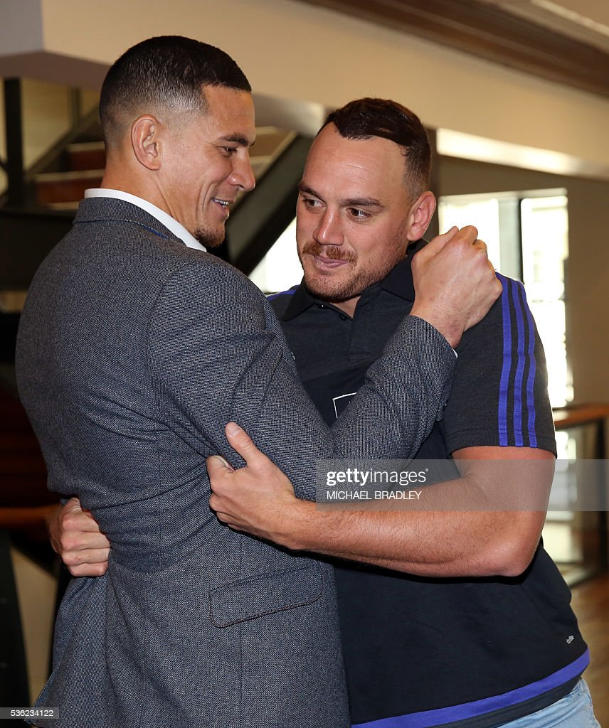 All Black Sonny Bill Williams (L) and All Blacks Israel Dagg (R) after it was announced that Sonny Bill Williams has signed a three year deal with the New Zealand Rugby Union and will play for the Auckland Blues next year in Auckland on June 01, 2016. / AFP / MICHAEL