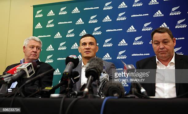 All Black Sonny Bill Williams with NZRU Chief Executive Steve Tew and All Blacks Coach Steve Hansen speak to the media June 1 2016 in Auckland after...