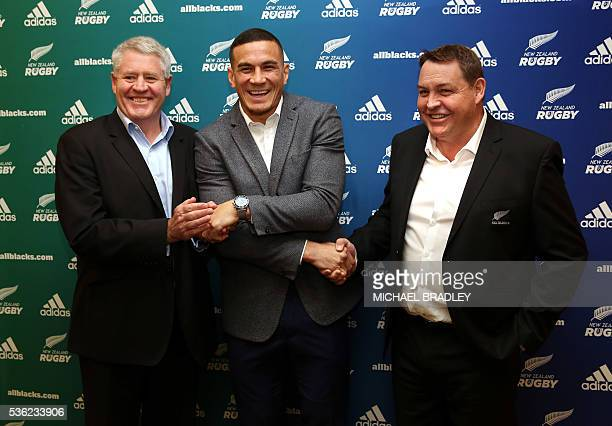 All Black Sonny Bill Williams with NZRU Chief Executive Steve Tew and All Blacks Coach Steve Hansen shake hands after it was announced that Sonny...
