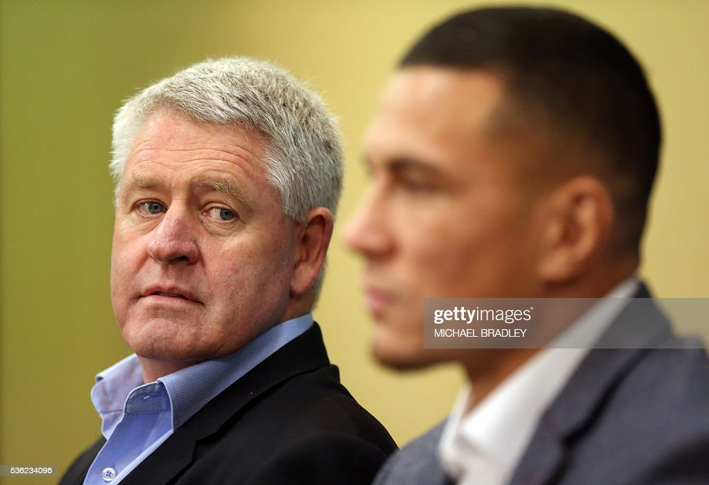 All Black Sonny Bill Williams (R) with NZRU Chief Executive Steve Tew (L) speak to the media after it was announced that Sonny Bill Williams has signed a three year deal with the New Zealand Rugby Union and will play for the Auckland Blues next year in Auckland on June 01, 2016. / AFP / MICHAEL