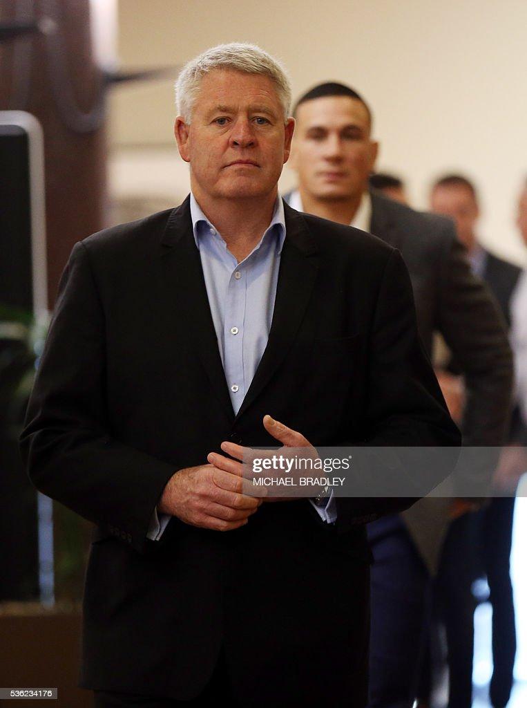 All Black Sonny Bill Williams (R) with NZRU Chief Executive Steve Tew (L) arrive to speak to the media after it was announced that Sonny Bill Williams has signed a three year deal with the New Zealand Rugby Union and will play for the Auckland Blues next year in Auckland on June 01, 2016. / AFP / MICHAEL