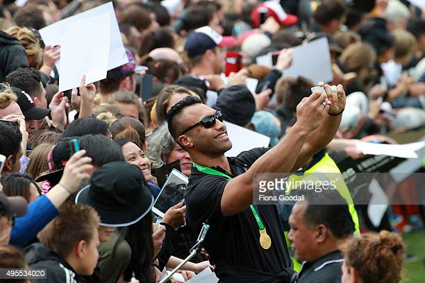 All Black Victor Vito poses with fans during the New Zealand All Blacks welcome home celebrations at Victoria Park on November 4 2015 in Auckland New...