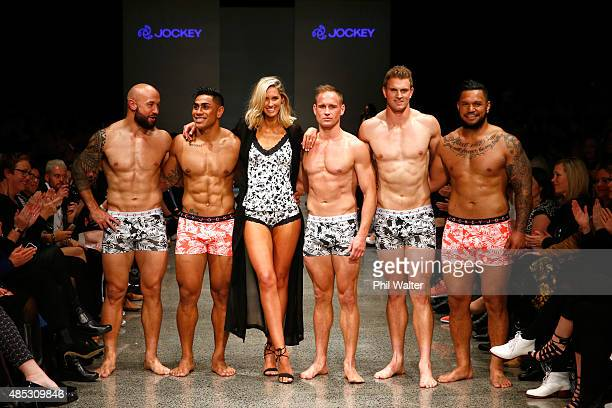 All Blacks and All Blacks Sevens players DJ Forbes Malakai Fekitoa Andy Ellis Scott Curry and Hika Elliot pose with Nikki Phillips during the Jockey...