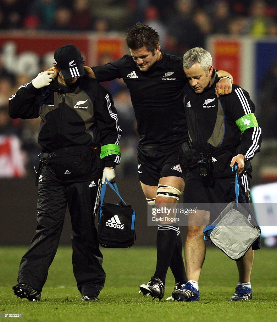 All Blacks captain Richie McCaw is helped off the field after an injury during the second Iveco Series test match between the New Zealand All Blacks...