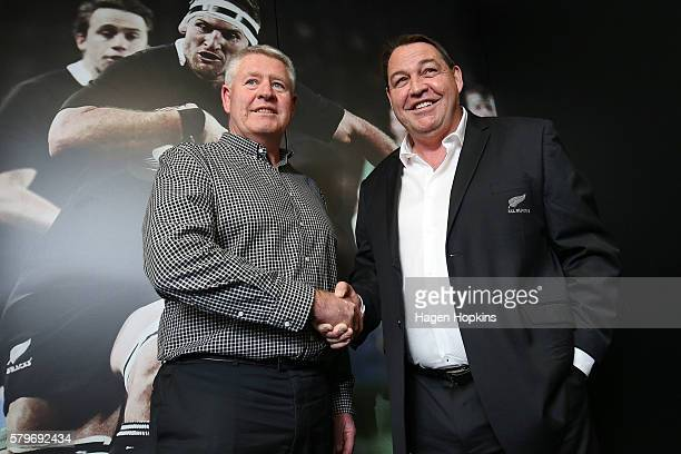 All Blacks coach Steve Hansen and NZRU CEO Steve Tew shake hands after announcing Hansen's reappointment during a New Zealand Rugby press conference...