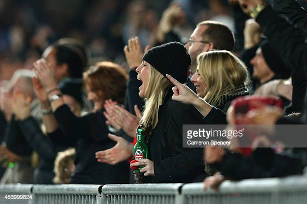 All Blacks fans celebrate a try during The Rugby Championship match between the New Zealand All Blacks and the Australian Wallabies at Eden Park on...