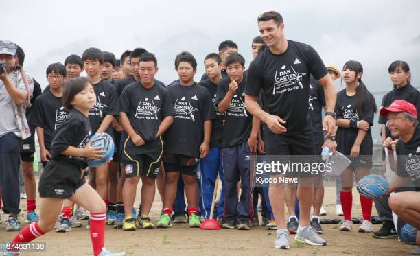 All Blacks legend Dan Carter holds a rugby clinic for children on July 17 during an event at the construction site for the 2019 Rugby World Cup match...