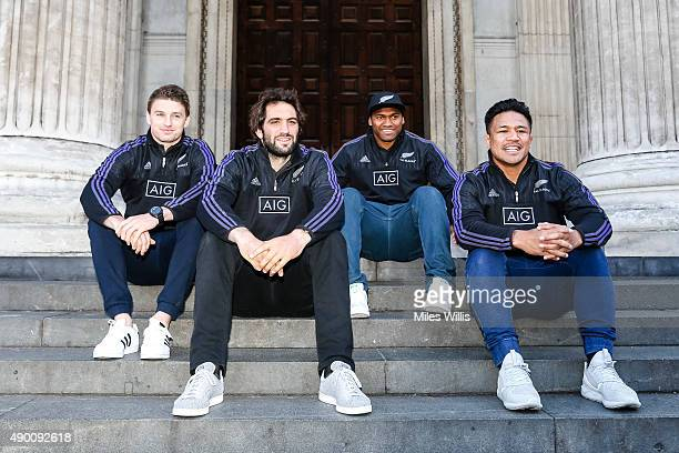All Blacks players Beauden Barrett Sam Whitelock Keven Mealamu and Waisake Naholo sit on the steps of St Paul's Cathedral during an open top bus tour...