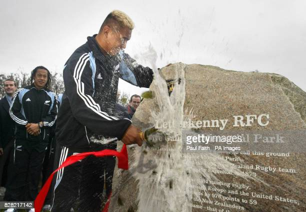 All Blacks star Jerry Collins smashes a bottle of champagne and offically names the 'Dave Gallaher Memorial Park' at a ceremony in Letterkenny Co...